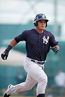 New York Yankees Eduardo Navas (10) runs to first base during an Instructional League game against the Pittsburgh Pirates on September 28, 2017 at Pirate City in Bradenton, Florida.  (Mike Janes/Four Seam Images)