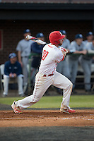 Thomas Yoder (20) of the Belmont Abbey Crusaders follows through on his swing against the Catawba Indians at Abbey Yard on February 7, 2017 in Belmont, North Carolina.  The Crusaders defeated the Indians 12-9.  (Brian Westerholt/Four Seam Images)