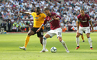 West Ham United's Andriy Yarmolenko and Wolverhampton Wanderers' Willy Boly<br /> <br /> Photographer Rob Newell/CameraSport<br /> <br /> The Premier League - West Ham United v Wolverhampton Wanderers - Saturday 1st September 2018 - London Stadium - London<br /> <br /> World Copyright © 2019 CameraSport. All rights reserved. 43 Linden Ave. Countesthorpe. Leicester. England. LE8 5PG - Tel: +44 (0) 116 277 4147 - admin@camerasport.com - www.camerasport.com