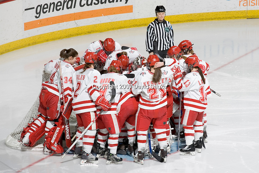 MADISON, WI - FEBRUARY 16: The Wisconsin Badgers women's hockey team huddles prior to the game against the Bemidji State Beavers at the Kohl Center on February 16, 2007 in Madison, Wisconsin. The Badgers beat the Beavers 2-0. (Photo by David Stluka)