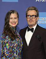 PALM SPRINGS, CA - JANUARY 3: Gisele Schmidt, Gary Oldman, at the 2019 Palm Springs International Film Festival Awards Gala at the Palm Springs Convention Center in Palm Springs, California on January 3, 2019.       <br /> CAP/MPI/FS<br /> &copy;FS/MPI/Capital Pictures