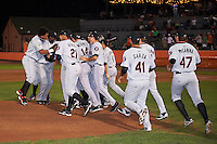 Tri-City ValleyCats players mob pitcher Zac Person after the final out of a game against the Aberdeen Ironbirds on August 6, 2015 at Ripken Stadium in Aberdeen, Maryland.  Tri-City defeated Aberdeen 5-0 as Kevin McCanna, Ralph Garza and Person combined to throw a no-hitter.  (Mike Janes/Four Seam Images)