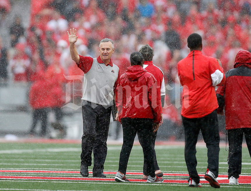 Former OSU coach Jim Tressel accepts an award between quarters during the first half of the NCAA football game between the Ohio State Buckeyes and the Northern Illinois Huskies at Ohio Stadium on Saturday, September 19, 2015. (Columbus Dispatch photo by Jonathan Quilter)
