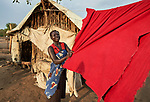 A woman gathers in her laundry in the Doro Refugee Camp in Maban County, South Sudan. Doro is one of four camps in Maban that together shelter more than 130,000 refugees from the Blue Nile region of Sudan. Jesuit Refugee Service provides educational and psycho-social services to both refugees and the host community. <br /> <br /> Misean Cara supports the work of JRS in the Maban camps.