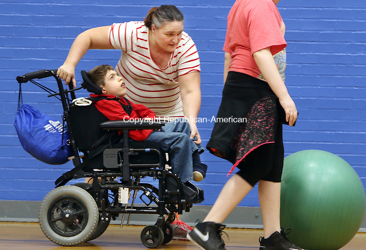 NORTH CANAAN CT. 10 March 2016-031016SV07- Betty Swiderski, Special Ed Paraprofessional, helps Walter Hayward, 11, with gym class at North Canaan Elementary School in North Canaan Thursday.<br /> Steven Valenti Republican-American