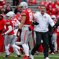 Ohio State Buckeyes head coach Urban Meyer grabs the arm of Ohio State Buckeyes tight end Nick Vannett (81) during pre-game warm-ups before Saturday's NCAA Division I football game at Ohio Stadium in Columbus on November 23, 2013. (Barbara J. Perenic/The Columbus Dispatch)
