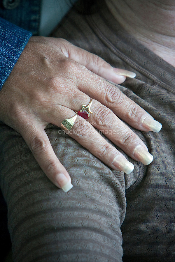 Cuba, Cienfuegos.  Long Fingernails Designate a Professional Woman, i.e., one who does not dirty her hands while working.