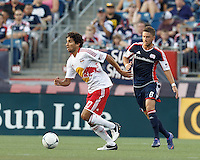 New York Red Bulls midfielder Mehdi Ballouchy (10) dribbles as New England Revolution defender Chris Tierney (8) closes. In a Major League Soccer (MLS) match, New England Revolution defeated New York Red Bulls, 2-0, at Gillette Stadium on July 8, 2012.