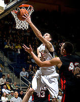 David Kravish of California tosses the ball into a basket during the game against Utah at Haas Pavilion in Berkeley, California on January 14th, 2012.  California defeated Utah, 81-45.