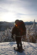 Appalachian Trail - A winter hiker stands on the summit of Mount Moriah during the winter months in the White Mountains, New Hampshire USA