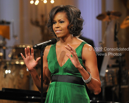 """Washington, D.C. - February 25, 2009 -- First lady Michelle Obama makes opening remarks as she and United States President Barack Obama host """"Stevie Wonder In Performance at the White House: The Library of Congress Gershwin Prize"""" to showcase an evening of celebration at the White House in honor of musician Stevie Wonder's receipt of the Library of Congress Gershwin Prize for Popular Song in the East Room of the White House in Washington, D.C. on Wednesday, February 25, 2009..Credit: Ron Sachs / Pool via CNP"""