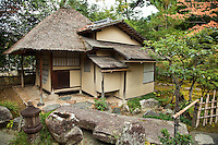 """Ihoan Hut at Kodaiji Temple Garden; At Kodai-ji temple there are several formal gardens designed by Kobori Enshu, who was an architect and master Zen gardener, as well as a master of calligraphy, poetry, and tea ceremony. The Ihoan tea hut or """"Cottage of Lingering Fragrance"""" is one more element of Kobori Enshu's garden design, considering his interest in tea ceremony as well as gardening."""