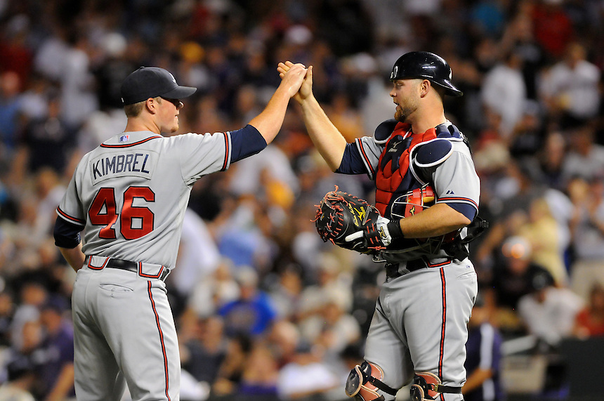 18 JULY 2011:   Atlanta Braves relief pitcher Craig Kimbrel (46) and Atlanta Braves catcher Brian McCann (16) celebrate Kimbrel's 29th save of his rookie season during a regular season game between the Atlanta Braves and the Colorado Rockies at Coors Field in Denver, Colorado. The Braves beat the Rockies 7-4. *****For Editorial Use Only*****
