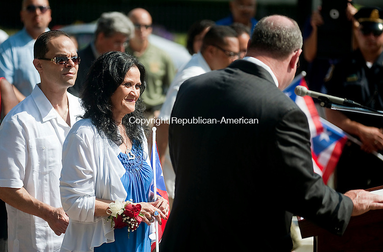 WATERBURY, CT-27 JULY 2012--072712JS04- Miriam Echevarria, the 2012 Puerto Rican Mayor for the day, is all smiles as Waterbury Mayor reads a proclamation during a ceremony Friday at City Hall in Waterbury.The event was part of the Hispanic Coalition of Greater Waterbury's 27th annual Puerto rican flag raising ceremony. .Jim Shannon Republican-American