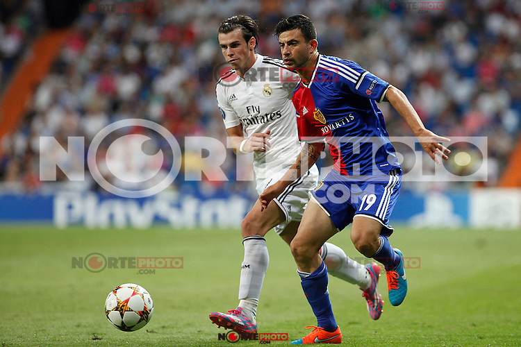 Gareth Bale of Real Madrid and Behrang Safari of FC Basel 1893 during the Champions League group B soccer match between Real Madrid and FC Basel 1893 at Santiago Bernabeu Stadium in Madrid, Spain. September 16, 2014. (ALTERPHOTOS/Caro Marin) /NortePhoto.com