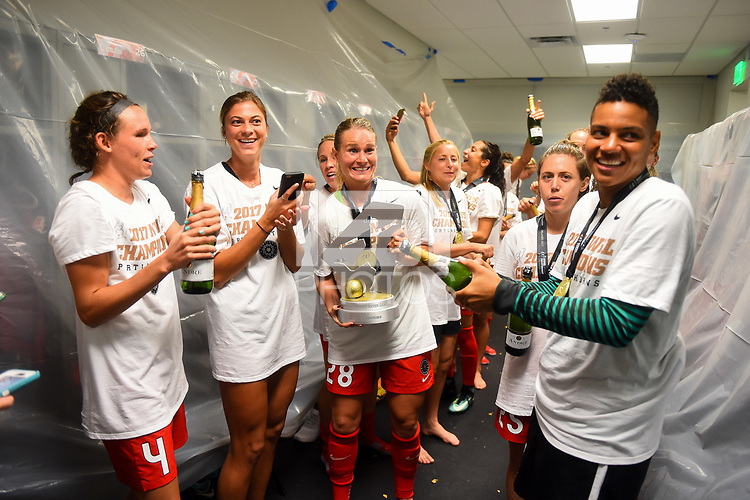 Orlando, FL - Saturday October 14, 2017:  Amandine Henry , Portland Thorns FC celebrate their National Women's Soccer League (NWSL) Championship win by defeating North Carolina Courage 1-0 during the NWSL Championship match between the North Carolina Courage and the Portland Thorns FC at Orlando City Stadium.