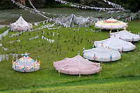 Prayer flags in the shape of auspicious umbrellas bless the world in Derge county - Kham (E. Tibet), Sichuan Province, China