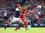 Scotland's Charlie Mulgrew tussles with England's Harry Kane during the FIFA World Cup Qualifying match at Hampden Park Stadium, Glasgow Picture date 10th June 2017. Picture credit should read: David Klein/Sportimage