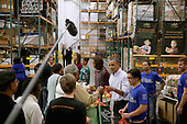"""United States President Barack Obama, first lady Michelle Obama, and their daughters Malia Obama, 15 and Sasha Obama, 12, help pack and distribute bags of food to needy children and seniors at the Capital Area Food Bank November 27, 2013 in Washington, DC. According to the White House, the first family was joined by family and friends and members of The Mission Continues, """"an organization of post-9/11 veterans who are awarded community service fellowships.""""  <br /> Credit: Chip Somodevilla / Pool via CNP"""