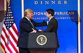 President Donald Trump (L) greets Speaker of the House Paul Ryan, R-WI, as he arrives on stage to delivers remarks at the National Republican Congressional Committee March Dinner at the National Building Museum on March 20, 2018 in Washington, D.C. <br /> Credit: Kevin Dietsch / Pool via CNP