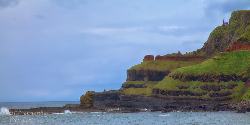 """Looking at the """"chimney tops"""" at the Giants Causeway on the Antrim Coast in North Ireland."""