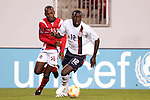 13 March 2008: Jozy Altidore (USA) (12) dribbles past Adolfo Machado (PAN) (13). The United States U-23 Men's National Team defeated the Panama U-23 Men's National Team 1-0 at Raymond James Stadium in Tampa, FL in a Group A game during the 2008 CONCACAF's Men's Olympic Qualifying Tournament.