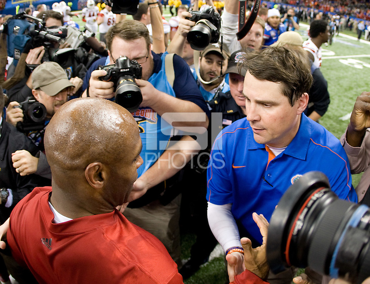 Louisville head coach Charlie Strong shakes hands with Florida head coach Will Muschamp after 79th Sugar Bowl game at Mercedes-Benz Superdome in New Orleans, Louisiana on January 2nd, 2013.   Louisville Cardinals defeated Florida Gators, 33-23.