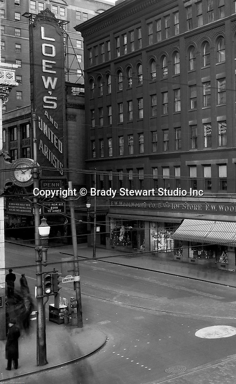 Pittsburgh PA:  View of the FW Woolworth Building and Loew's Movie Theater at the corner of Sixth Street and Liberty Ave. - 1935. Born To Dance was playing at the movies and local boy Jimmy Stewart was a headliner.
