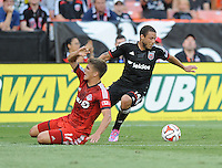 Washington D.C. - July 30, 2014:  Nick DeLeon (14) of D.C. United goes against Nick Hagglund (17) of Toronto FC. D.C. United defeated the Toronto FC 3-1 during a Major League Soccer match for the 2014 season at RFK Stadium.