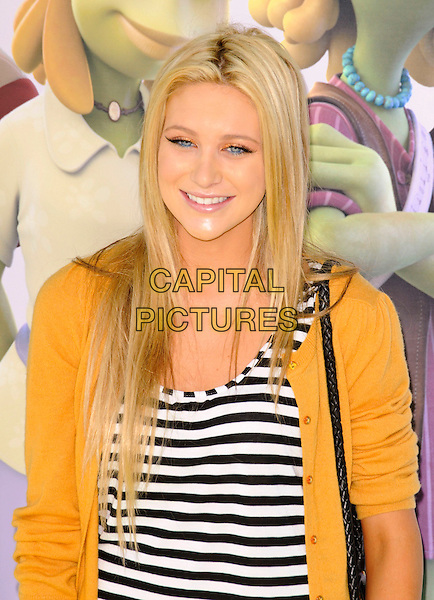 "STEPHANIE PRATT .arriving at the film premiere for ""Planet 51"" at Mann Village Theatre in Westwood, California, USA, .November 14th, 2009..portrait headshot  yellow cardigan black and white striped top smiling .CAP/ROT.©Lee Roth/Capital Pictures."