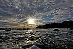 The Sun sets over Muir Beach outside of San Francisco, California