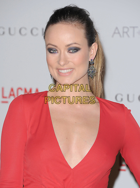 Olivia Wilde.The Inaugural Art and Film Gala held at LACMA in Los Angeles, California, USA..November 5th, 2011   .headshot portrait red low cut neckline cleavage eyeshadow eyeliner make-up beauty .CAP/RKE/DVS.©DVS/RockinExposures/Capital Pictures.