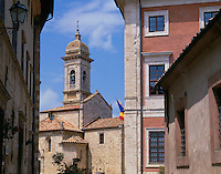 Tuscany, Italy:  Street view of Collegiata, a 12th century Romanesque church near Piazza Chigi in the hill town of San Quirico d'Orcia