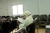 A woman reads during a multimedia lecture by Dr Manal Abul Hassan, in FJP headquarters in Downtown, Cairo. Egypt, October 2012.
