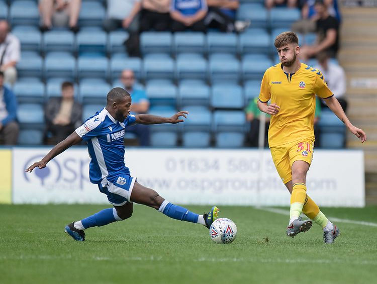 Bolton Wanderers' Jordan Boon (left) under pressure from Gillingham's Mark Marshall (right) <br /> <br /> Photographer David Horton/CameraSport<br /> <br /> The EFL Sky Bet League One - Gillingham v Bolton Wanderers - Saturday 31st August 2019 - Priestfield Stadium - Gillingham<br /> <br /> World Copyright © 2019 CameraSport. All rights reserved. 43 Linden Ave. Countesthorpe. Leicester. England. LE8 5PG - Tel: +44 (0) 116 277 4147 - admin@camerasport.com - www.camerasport.com
