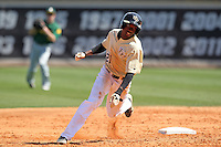 UCF Knights shortstop Darnell Sweeney #21 rounds second base during a game against the Siena Saints at the UCF Baseball Complex on March 4, 2012 in Orlando, Florida.  Central Florida defeated Siena 15-2.  (Mike Janes/Four Seam Images)