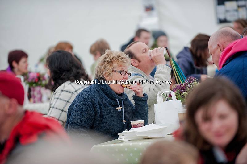 Thursday  29 May 2014, Hay on Wye, UK<br /> Pictured:A man munches his way through lunch at the Festival <br /> Re: The Hay Festival, Hay on Wye, Powys, Wales UK.