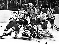 Seals Ron Stackhouse and Dick Redmond help goalie.Gary Smith against the Boston Bruins Wayne Carleton #11.(1971 photo/Ron Riesterer)