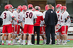 Orange, CA 03-05-17 - The Chapman team and Coach Hartley on the sidelines during a time out. in action during the UCLA - Champman Southern Lacrosse Conference MCLA Division 1 Men's Lacrosse game.