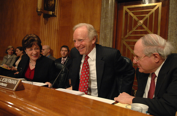 Chairman of the Homeland Security and Governmental Affairs Committee Joe Lieberman, D-Conn., settles in for a hearing on the Department's budget request for FY2008 as ranking member Sue Collins, R-Me., and Sen. Carl Levin, D-Mich., look on.  Homeland Security Secretary Michael Chertoff testified.