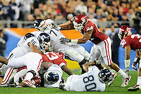 Jan. 1, 2011; Glendale, AZ, USA; Oklahoma Sooners defensive end (84) Frank Alexander hits Connecticut Huskies offensive tackle (71) Mike Ryan in the 2011 Fiesta Bowl at University of Phoenix Stadium. The Sooners defeated the Huskies 48-20. Mandatory Credit: Mark J. Rebilas-.