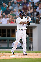 Jared Mitchell (9) of the Charlotte Knights at bat against the Norfolk Tides at BB&T BallPark on April 9, 2015 in Charlotte, North Carolina.  The Knights defeated the Tides 6-3.   (Brian Westerholt/Four Seam Images)