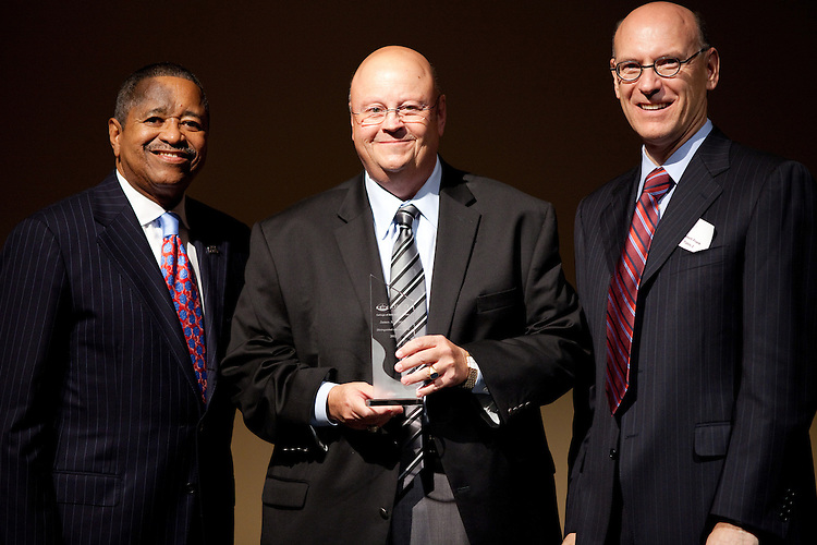 President McDavis, James Wycoff, and Bob Frank pose for a portrait at the College of Arts and Sciences Distinguished Alumni Awards Dinner and Ceremony on October 4, 2012..Photo by Chris Franz