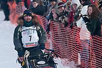 Warren Palfrey team leaves the start line during the restart day of Iditarod 2009 in Willow, Alaska