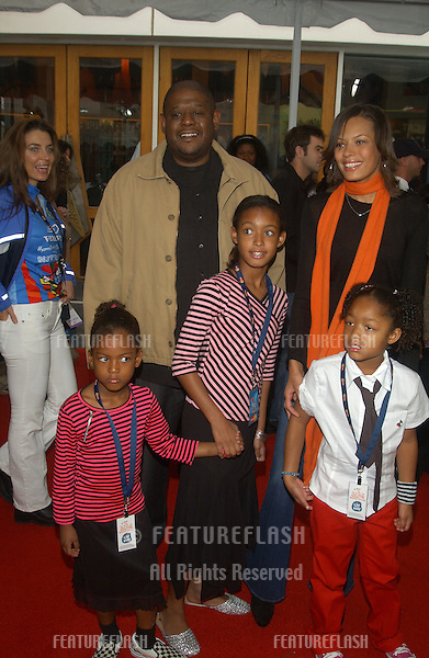 Actor FOREST WHITAKER & family at the world premiere, in Hollywood, of Dr. Suess' The Cat in the Hat..November 8, 2003
