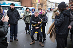 © Joel Goodman - 07973 332324 .  12/01/2015 . Salford , UK . BEZ ( Mark Berry ) (putting on a safety harness) launches his parliamentary campaign for the constituency of Salford and Eccles at a poster site on Chapel Street , Salford . Bez , the freaky dancer from Madchester band The Happy Mondays , is standing for The Reality Party . Seat incumbent , Labour's Hazel Blears , is standing down at the 2015 election . Photo credit : Joel Goodman