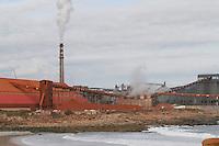 Fecha: 02-10-2012. (Lugo), El Ministro Soria visita la factoria de Alcoa en San Cibrao. En la imagen una vista de la fabrica de aluminios, y los barros rojos.