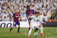 1st March 2020; Estadio Santiago Bernabeu, Madrid, Spain; La Liga Football, Real Madrid versus Club de Futbol Barcelona; Luka Modric (Real Madrid) holds up the ball from Samuel Umtiti (FC Barcelona)