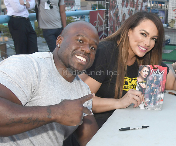 Brooklyn, NY - AUGUST 17: WWE Superstars Apollo Crews and Nia Jax visits MCU Park in Brooklyn, New York on August 17, 2017 during Summer Slam Week. Photo Credit: George Napolitano/MediaPunch