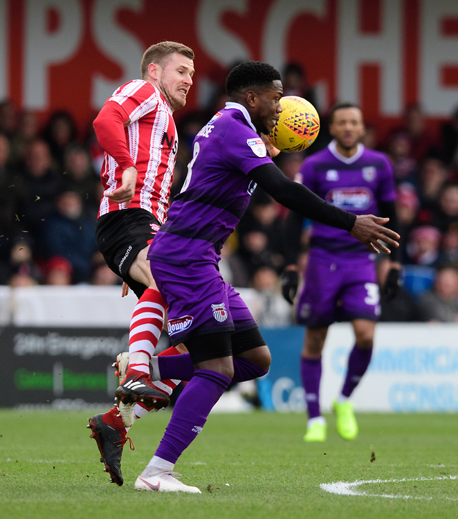 Lincoln City's Michael O'Connor vies for possession with Grimsby Town's Mitch Rose<br /> <br /> Photographer Chris Vaughan/CameraSport<br /> <br /> The EFL Sky Bet League Two - Lincoln City v Grimsby Town - Saturday 19 January 2019 - Sincil Bank - Lincoln<br /> <br /> World Copyright &copy; 2019 CameraSport. All rights reserved. 43 Linden Ave. Countesthorpe. Leicester. England. LE8 5PG - Tel: +44 (0) 116 277 4147 - admin@camerasport.com - www.camerasport.com